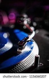 KIEV-4 JULY,2018: Professional dj turntable plays vinyl record with music. Retro Technics SL1210 turn table player device with Shure M44 needle playing musical tracks on concert in night club