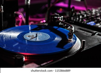 KIEV-4 JULY,2018: Retro Technics SL-1210 turntable vinyl records player on stage.Professional vintage dj audio equipment on concert scene.Shure M44 needle scratch analog record with music in the club