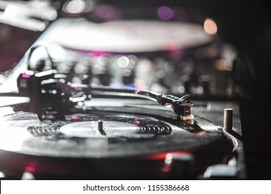 KIEV-4 JULY,2018: Retro Technics turntable plays vinyl record with music on concert in nightclub.Professional DJ audio setup on table in the club.SL 1210 turn table records player and Shure M44 needle