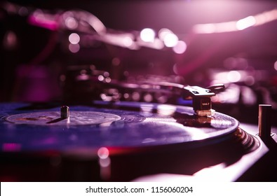 KIEV-4 JULY,2018: Technics SL-1210 turntable records player and Shure M44 needle for playing musical tracks. Scratch vinyl record with hip hop music on party in night club.Professional audio equipment