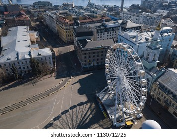 KIEV-9 APIRIL,2018: Aerial drone photo of ferris wheel in center of Kyiv in Ukraine. Flying DJI quadro copter shoot city views from above.Popular tourist destination in Ukrainian capital city