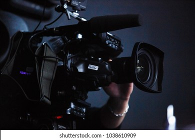 KIEV-9 FEBRUARY,2018:Professional video camera man film concert on stage.Big pro 4k video cam shoots live broadcast footage for television.TV camera operator shooting videos on concert stage