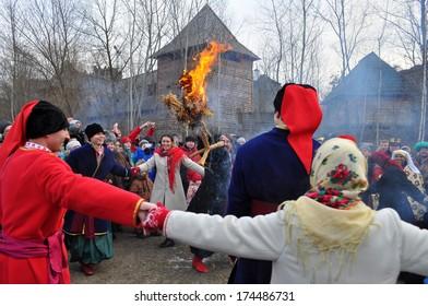 "KIEV-JANUARY 19: Folk Ukrainian Group celebrating the Religious Christian holiday a Epiphany. Museum under opened by sky ""Mamaeva Sloboda"", January 19, 2014 in Kiev, Ukraine"