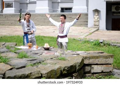 KIEV,UKRAINE - JUNE 1:unidentified ukrainian pagan community making ritual ceremony dedicated to Perun,Slavic god of Thunder,near National Museum of History on June 1,2014 in Kiev,Ukraine