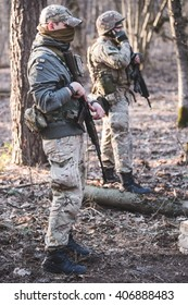 "KIEV,UKRAINE - March 26 : Two volunteers with guns in forest during military training ""RUH 100.Tryzub"" for civilians in Kiev,Ukraine on March 26,2016."