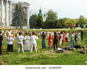 KIEV,UKRAINE - MAY 20:unidentified ukrainian pagan people are praying to Perun,god of Thunder in Slavic mythology near National Museum of History on May 20,2012 in Kiev,Ukraine