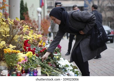 KIEV,UKRAINE - November 14, 2015: People lay flowers at the French Embassy in Kiev in memory of the victims of the November 13 terror attacks in Paris.