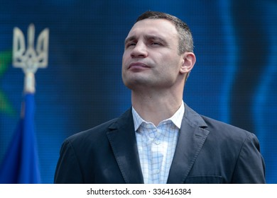 Kiev,Ukraine - Oct. 25, 2015: Kiev's current mayor and former heavyweight boxing champion Vitali Klitschko pose for photo with soldiers after casting his vote at a polling station in an elections