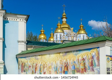 Kiev/Ukraine-04192019: An entrance wall to St Michael's Golden Domed Cathedral in Kiev. The wall is covered with paintings of saints and angels. Fish eye effect.