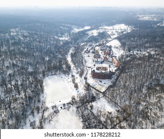 KIEV,UKRAINE-10 MARCH,2018:Aerial drone photo of Goloseevski Park forest and Christian Orthodox Cathedral in Kyiv.Quadrocopter overhead shot of snowy winter landscape from above