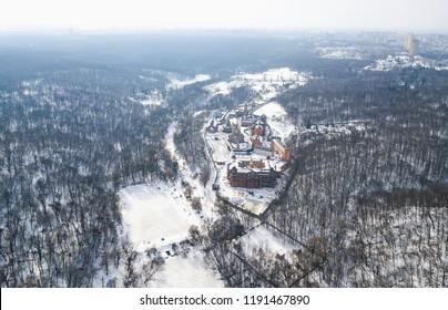 KIEV,UKRAINE-10 MARCH,2018:Aerial drone photo of Goloseevski Park forest in Kyiv.Quadrocopter overhead shot of snowy winter landscape in Ukraine.DJI Mavic Pro flying camera shoots frozen river