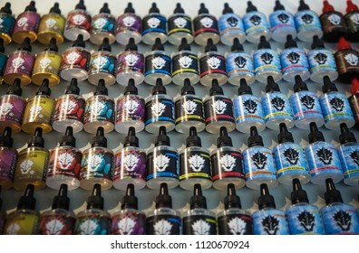 KIEV,UKRAINE-14 APRIL,2018:Buy new tasty vape juice for smoking with electronic vaping devices.Vape Expo sale for smokers.Plastic bottle containers with ejuice glycerin liquid in vaper store