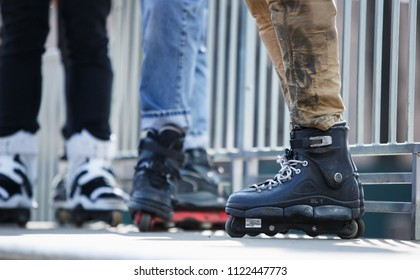 KIEV,UKRAINE-15 APRIL,2018:Aggressive inline roller blader wearing modern skates for extreme skating.Feet of young athlete in in-line blades exercising in skatepark outdoor in summer