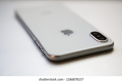 KIEV,UKRAINE-19 SEPTEMBER,2018: New Iphone XS model in close up.Newest Apple Ten S.White and silve smart phone with dual camera,glass back panel and endless screen.Trendy smartphone device copy