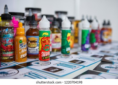 KIEV,UKRAINE-27 OCTOBER,2018: Plastic bottles with e-liquids for smoking tobacco with tasty fresh flavor.Buy new bottle with vape juice,quit smoking nicotine.Plastic containers with flavored glycerin