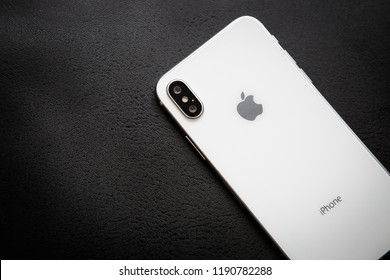 KIEV,UKRAINE-27 SEPTEMBER,2018:Iphone XS model.New Apple Ten S in white & silver color.Modern smartphone concept wit dual photo camera lenses on glass back panel.Luxury mobile phone in close up