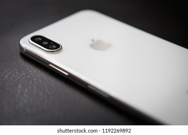 KIEV,UKRAINE-27 SEPTEMBER,2018:Iphone XS model.New Apple Ten Es in white and silver color.Modern smartphone concept wit dual photo camera lenses on glass back panel.Luxury mobile phone in close up