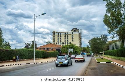 Kigali, Rwanda - August 29th 2015 - Cars moving in a street in a green area of Kigali downtown in Rwanda, East Africa.
