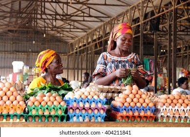 KIGALI, RWANDA - CIRCA AUGUST 2015: Rwandan women selling eggs to people visiting the Kimironko market in Rwanda's capital city.