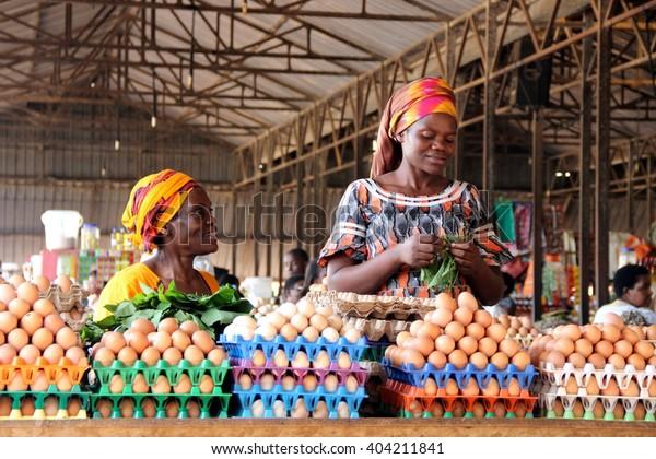 KIGALI, RWANDA - CIRCA AUGUST 2015: Rwandan women selling eggs to people visiting the Kimironko market in Rwanda's capital city.