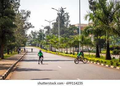 KIGALI, RWANDA - FEBRUARY 5, 2017: On car-free Sunday, a large portion of the major roads are closed off for residents to enjoy the streets for recreation like biking, running or walking.