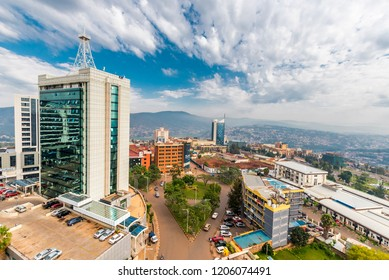 Kigali, Rwanda - September 21, 2018: a wide view looking down on the city centre with Pension Plaza in the foreground and Kigali City Tower in the background against a backdrop of distant blue hills