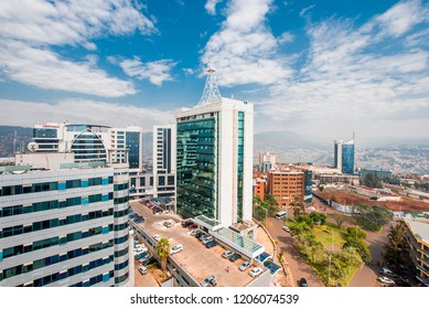 Kigali, Rwanda - September 21, 2018: a wide view looking down on the city centre with Ecobank and Pension Plaza in the foreground and Kigali City Tower in the background against a backdrop of hills