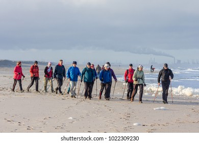 Kijkduin, The Hague, the Netherlands - 21 January 2018: seniors nordic walking on Kijkduin beach