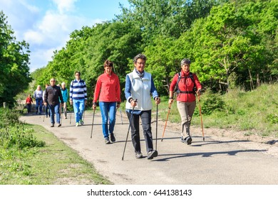 Kijkduin, the Netherlands - May 20, 2017: nordic walkers in a park
