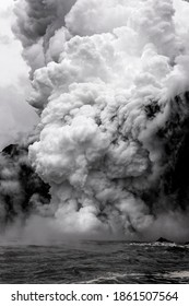Kilauea Volcano lava flow sends 2,000-degree magma through a lava tube that spills into the ocean, causing a giant plume of toxic steam to rise high into the atmosphere.