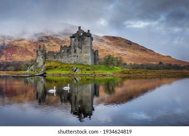 Kilchurn Castle on Loch Awe in the Scottish highlands near Glencoe and Oban. Historic castle in Scotland reflected in the loch with swans swimming past