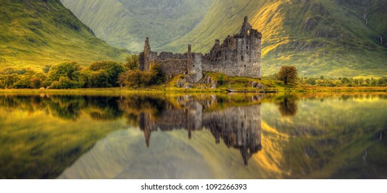 Kilchurn Castle reflection in Loch Awe at sunrise, Highlands, Scotland