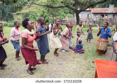 Kilembe, Uganda - October 22, 2016: Group of African people singing and dancing in church group in rural Uganda