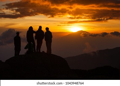 Kilimanjaro/Tanzania - January 26, 2018: A group of hikers watching sunset on mount Kilimanjaro in on of the camps.