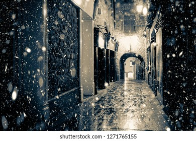 Kilkenny Ireland historic Butterslip alley with snowflakes falling during winter snow storm