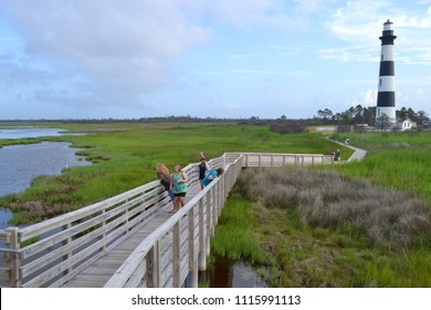 Kill Devil Hills, NC/United States- 06/21/2012: Visitors explore the area around the Bodie Island lighthouse on the outer banks of NC.