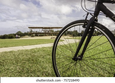 KILL DEVIL HILLS, NC/USA - OCTOBER 24, 2017: Bicycle wheel of a cyclist at Wright Brothers National Memorial, which honors the aerial feats of two pioneer aviators who built bicycles before airplanes.