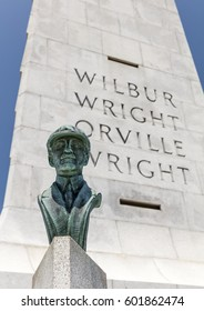 Kill Devil Hills, North Carolina , USA - 25 May 2016: Statue of Orville Wright in front of the Art Deco style Wright Brothers National Memorial on the Outer Banks at site of their first powered flight