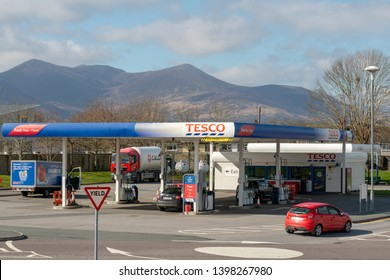 Killarney, County Kerry, Ireland, 26 March 2019. Tesco gas station at DeerPark shopping centre on sunny day. Distant mountains as background.