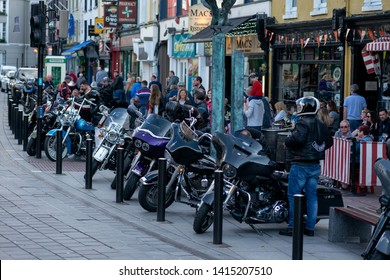 """Killarney, County Kerry, Ireland. 31 May 2019. """"Harley Davidson"""" Bike Fest gathering. Row of Harley Davidson motorbikes on Main Street in front of Reidy's bar - the most popular biker's spot in town."""