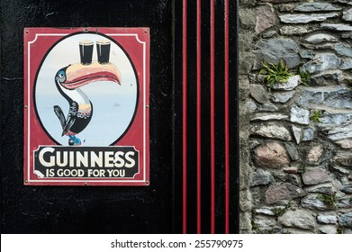 KILLARNEY, IRELAND - 14TH FEBRUARY 2015: Vintage Guinness sign outside traditional Irish pub in the town of Killarney, Ireland