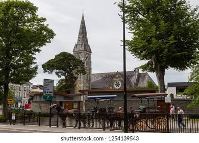 Killarney, Ireland -25th June, 2018: Killarney town centre, Horse and carts used to transport sightseeing tourists  around the Killarney area