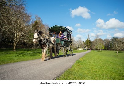 Killarney, Ireland - April 4th 2016: tourists enjoying a jaunting car tour through Killarney national park in the Ring of Kerry