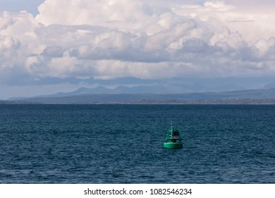 The Killeany buoy in Galway Bay with view of Connemara.  The approach to Killeany Bay is dangerous and is guarded by a Lighthouse on Straw Island to the South and the Killeany buoy to the North.