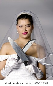 Killer bride photo series. Bridezilla holding knives. Studio shot