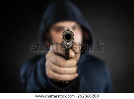 killer with gun isolated