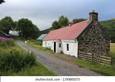 KILLIN, SCOTLAND, 22 JULY 2018: 19th c Moirlanich Longhouse, a cruck frame  cottage, in Glen Lochay near Killin. Sited on a public road it is maintained by the NT for Scotland and open to visitors.