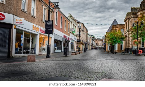 KILMARNOCK TOWN, SCOTLAND - SEPTEMBER 18, 2017: Portland Street Kilmarnock looking onto Bright House, Clarks, Costa, topshop and Peacocks and Mason & Murphy in the distance
