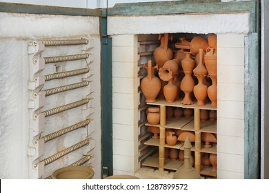 Kiln in Potter's workshop with pottery. Electric oven for ceramic clay products