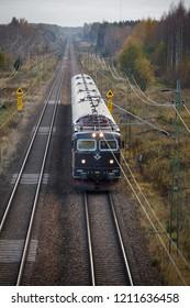 KILSMO, SWEDEN - OCTOBER 14, 2015: SJ passenger train passing on the line in Kilsmo, Sweden